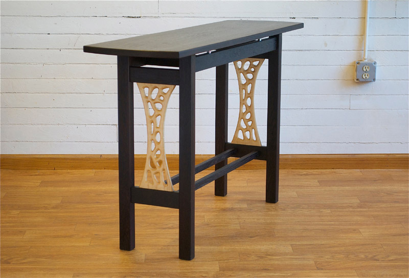 Wenge hallway table with sculpted maple side panels.  54