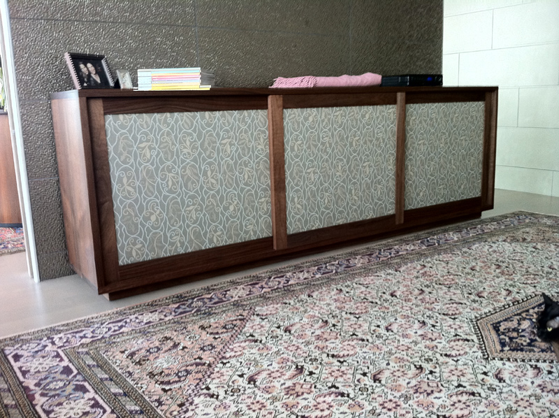 shoe cabinet- walnut case with pattern upholstery door panels-96